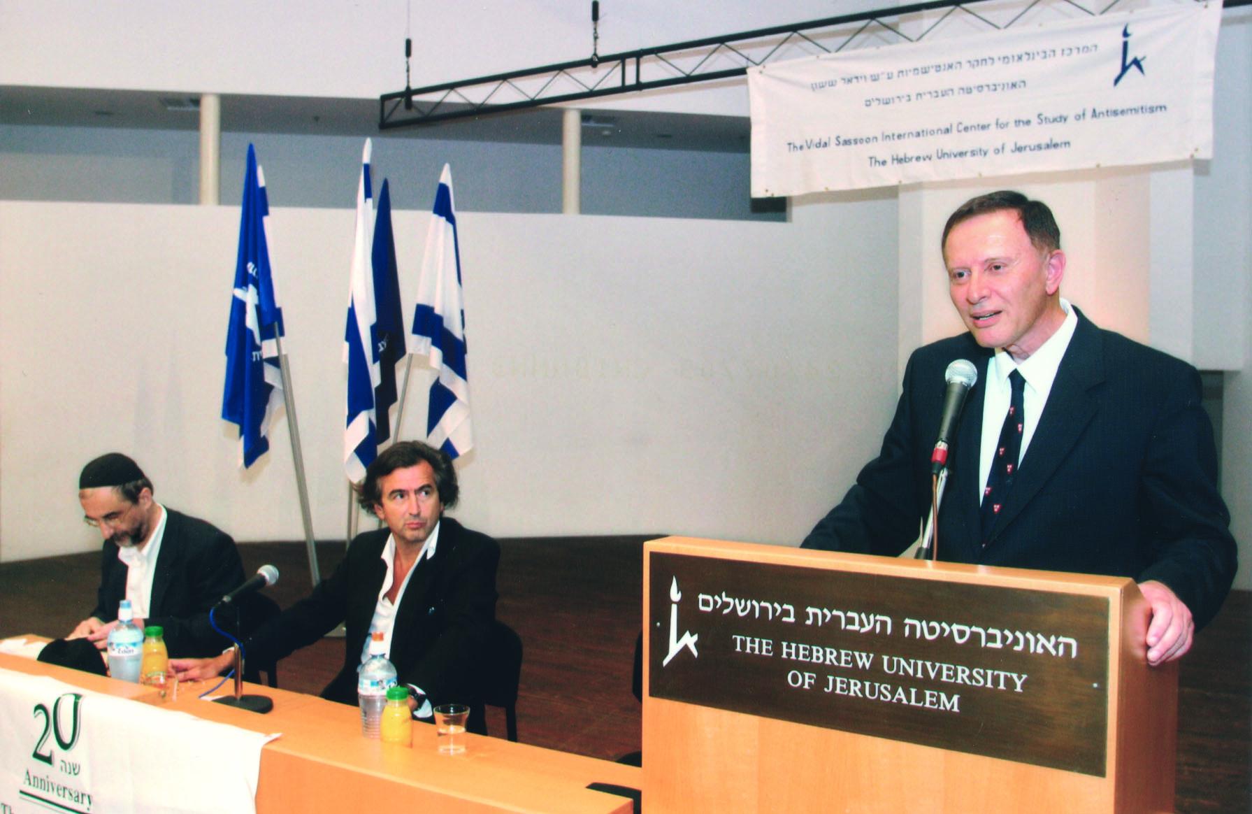 Bernard-Henri Lévy sitting beside Benny Lévy, listening to Robert Wistrich at the Hebrew Univeristy of Jerusalem