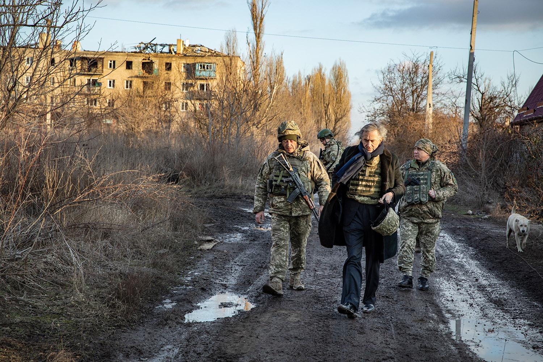 Bernard-Henri Lévy in Pisky, in the Donbass Region, walking with Ukrainian military, January 2020